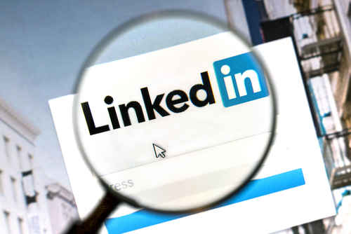 magnifying glass over LinkedIn page